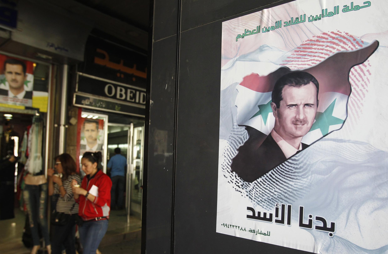 Cartazes da candidatura do presidente Bashar al-Assad nas ruas de Damasco. A família Assad governa o país há mais de 40 anos