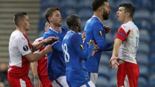 Flashpoint: Slavia Prague's Czech defender Ondrej Kudela (right) clashes with Rangers defender Connor Goldson