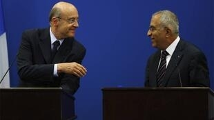 Alain Juppé with Palestinian Prime Minister Salam Fayyad during a joint news conference Thursday