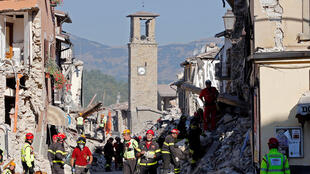 Firefighters and rescuers work following the August 2016 earthquake in Amatrice, central Italy.