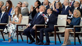 French President Emmanuel Macron, his wife Brigitte Macron, US President Donald Trump and First Lady Melania Trump at the Bastille Day parade last year