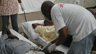 A Haitian resident suffering from cholera receives treatment at St-Catherine hospital