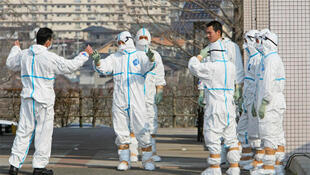 Japan Self Defence Force members prepare to transfer to hospital workers who were exposed to radiation