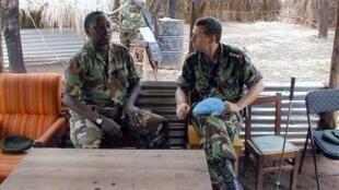 File photo (2001) of Col Emmanuel Karenzi Karake, in Pweto, Rwanda with UK Col British Army Colonel Simon Caraffi (r)