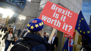 An anti-Brexit demonstrator stands outside the venue of the Conservative Party Conference in Birmingham, Britain on 1 October, 2018.