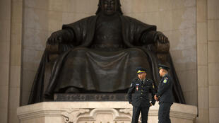 Officers stand guard in front of the statue of Genghis Khan at Sukhbaatar Square in the Mongolian capital, Ulaanbaatar.