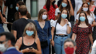 People wearing protective masks in Nantes as France reinforces mask-wearing to curb a resurgence of Covid-19, 24 August 2020.