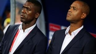 Cameroon's football bosses sacked Clarence Seedorf (left) and his assistant Patrick Kluivert for the team's poor showing at the Africa Cup of Nations.