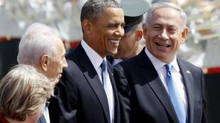 President Barack Obama with Israeli Prime Minister Benjamin Netanyahu (R) and President Shimon Peres upon his arrival at Ben Gurion International Airport in Tel Aviv