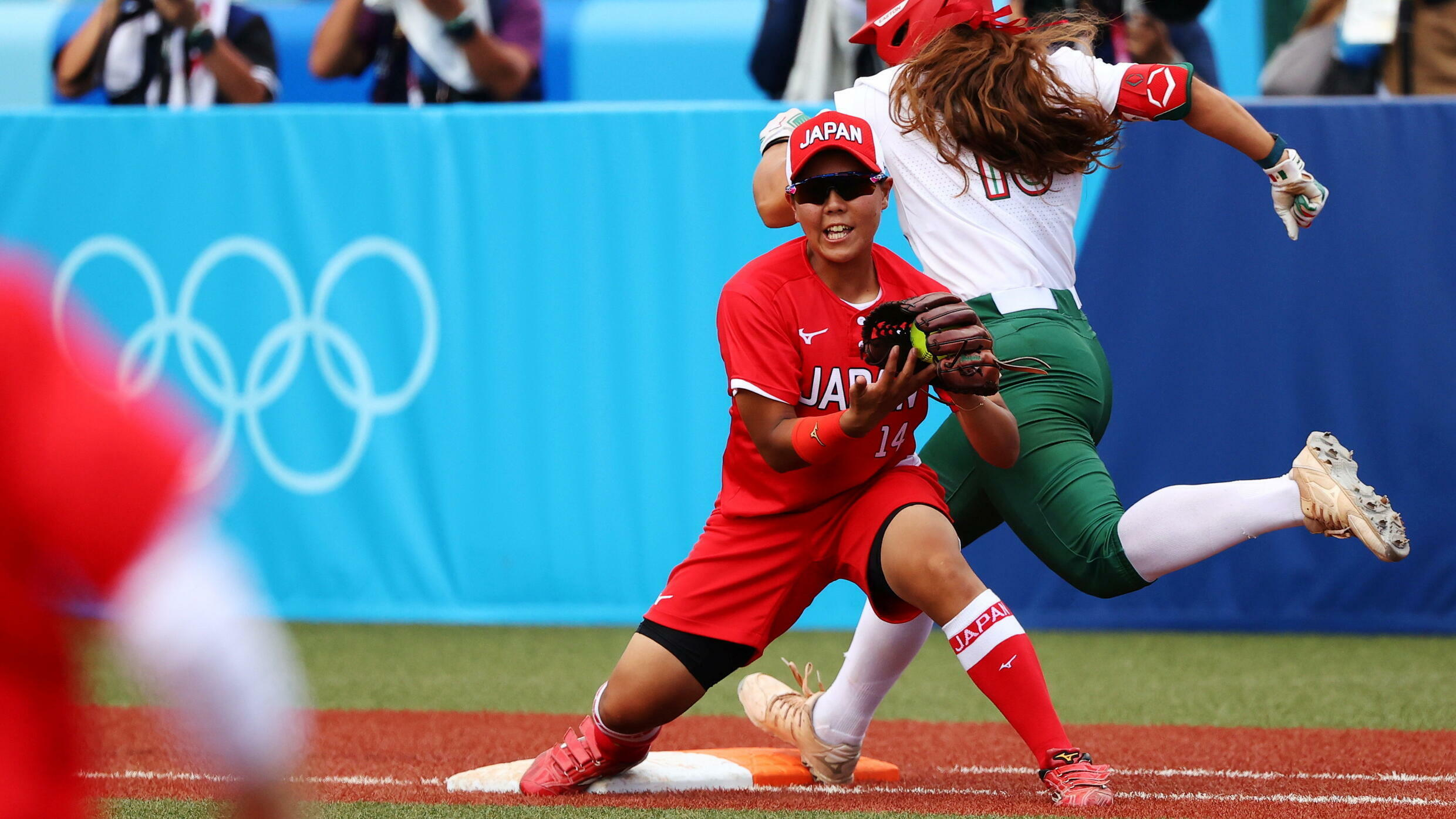 Japan's Minori Naito and Mexico's Nicole Rangel during the softball game between the Mexico and Japan during the Olympics in Tokyo.