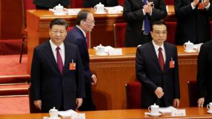Le président Xi Jinping et le Premier ministre Li Kegiang lors de l'ouverture de la session annuelle du Parlement chinois, en mars 2018.