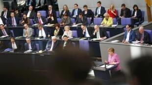 Angela Merkel s'exprime au Bundestag, à Berlin, le 16 mars 2016.