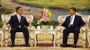 中国副主席习近平2011年7月4日在北京人民大会堂会见日本外相松元刚明。