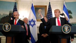 Tổng thống Mỹ Donald Trump (P) và thủ tướng Israel Benjamin Netanyahu tại Washington trong lễ ký sắc lệnh thừa nhận cao nguyên Golan thuộc về Israel, ngày 25/03/2019.