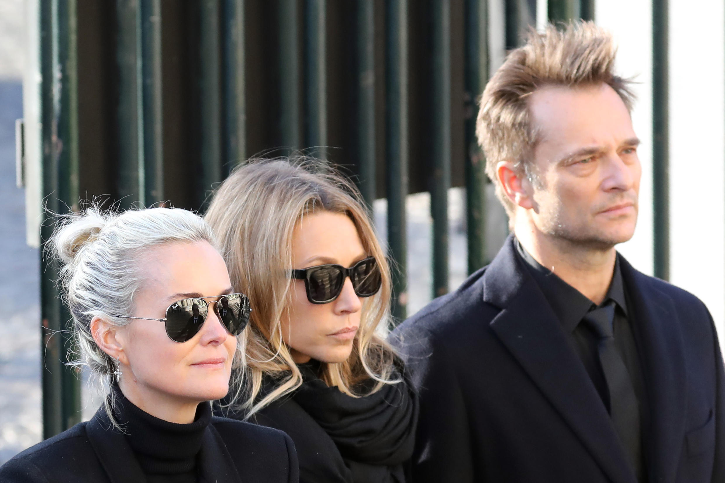 Laeticia Hallyday, (L), wife of late French singer Johnny Hallyday, son of Johnny Hallyday David Hallyday (R) and daughter Laura Smet (C) standing during the funeral ceremony for Johnny Hallyday at the Eglise de la Madeleine