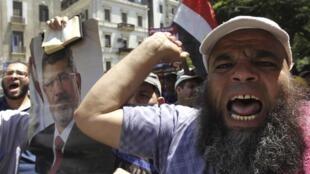 Des partisans du président déchu Mohamed Morsi, le 22 juillet au Caire.