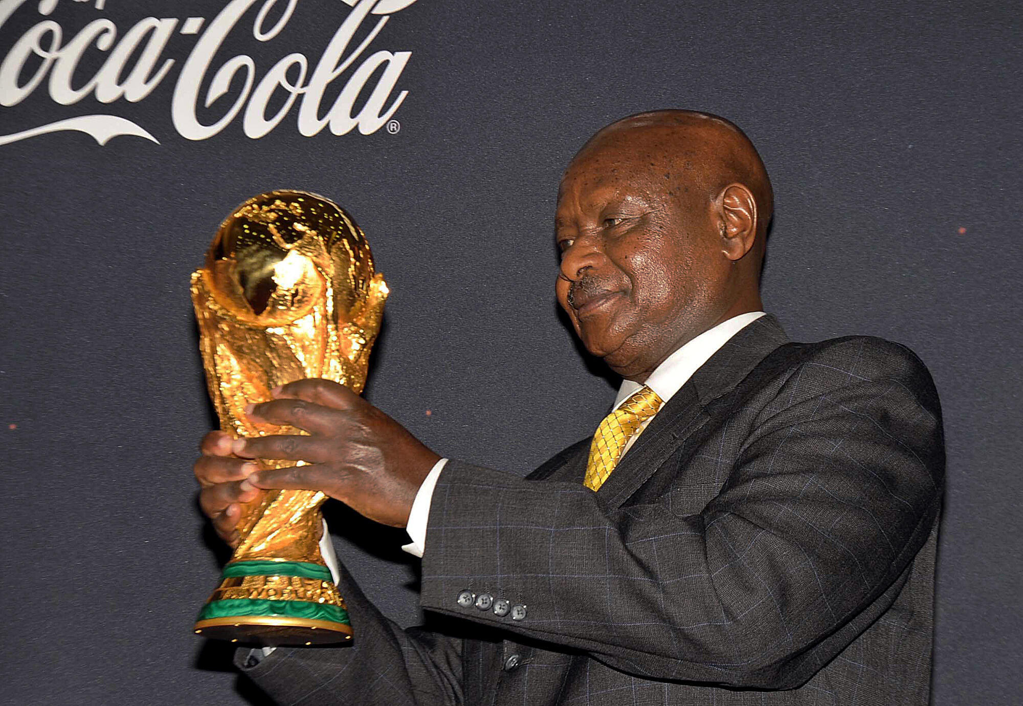 Museveni lifts the FIFA World Cup trophy at State House, Entebbe on 15 November 2009.