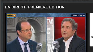 Президент Франсуа Олланд в прямом эфире BFMTV с журналистом Жан-Жаком Бурденом 6 мая 2014.