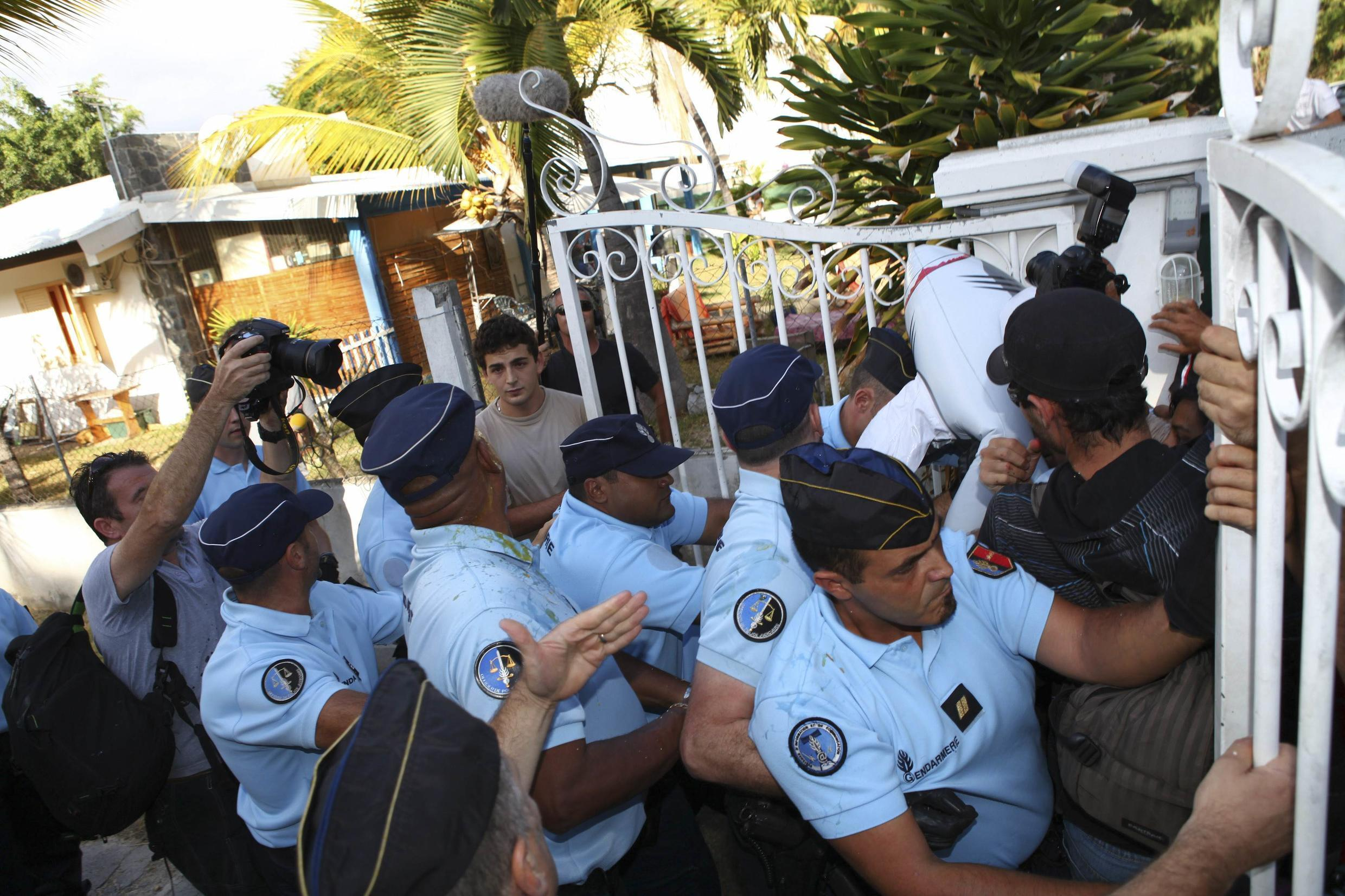 French gendarmes block demonstrators at the gates of the Reunion Marine Reserve on Tuesday