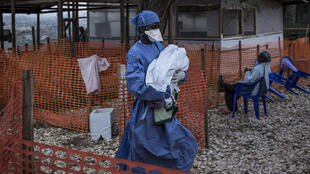 A health worker carries a four-day-old baby suspected of having Ebola into a MSF (Doctors Without Borders) supported Ebola Treatment Centre in Butembo, 4 November 2018.