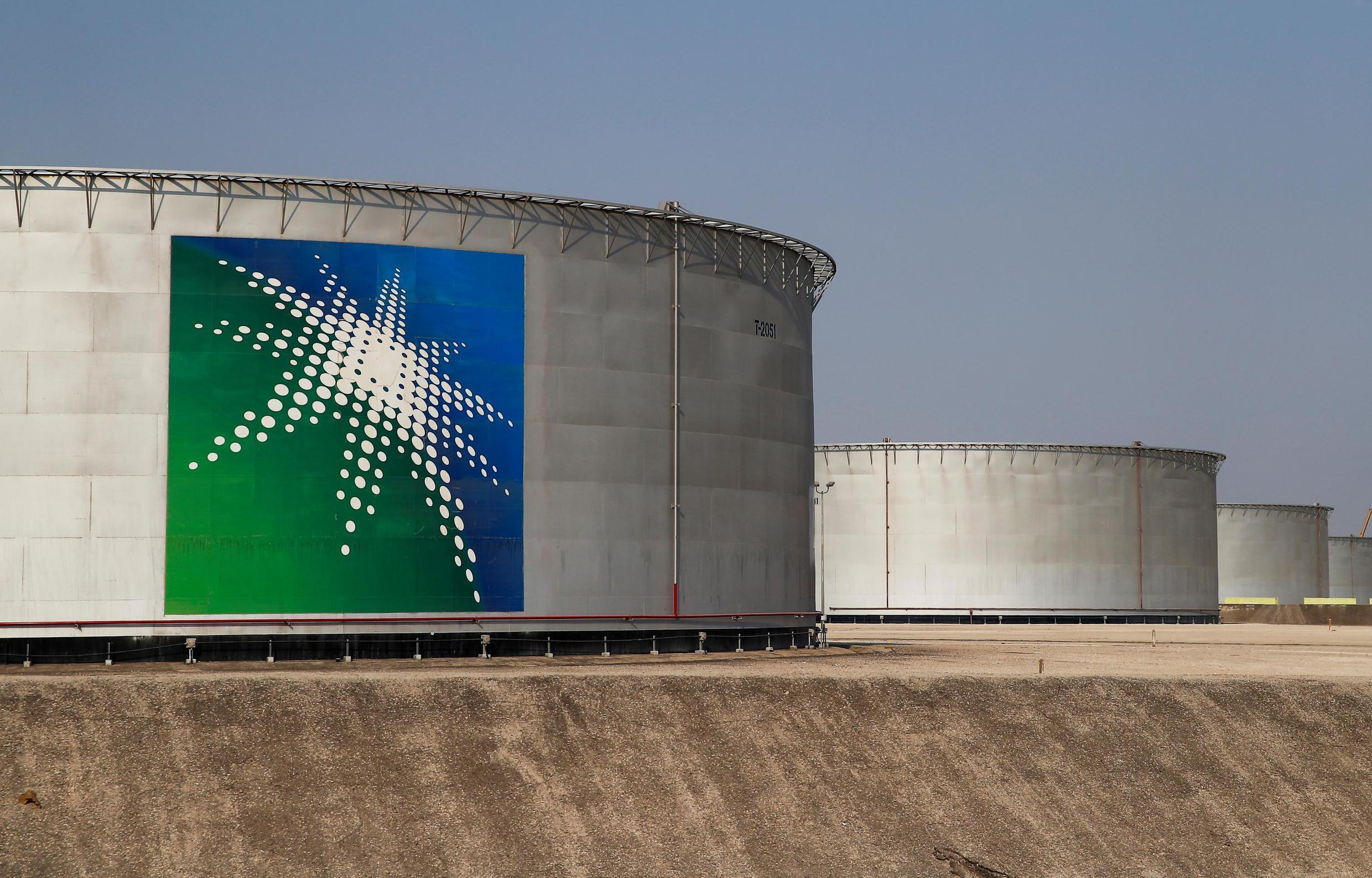 Oil tanks bearing the Saudi Aramco logo at the oil facility in Abqaiq, Saudi Arabia, in October 2019. The Gulf kingdom is looking to set a world IPO record by selling of 1.5 percent of the company.