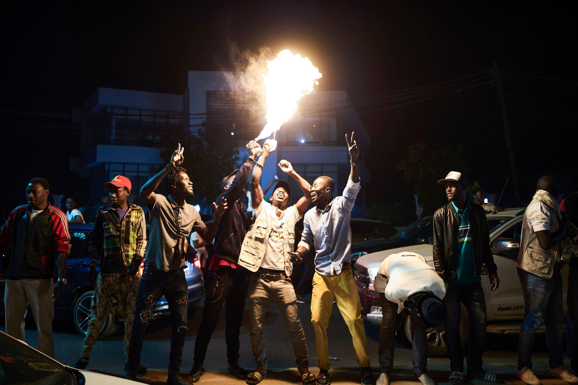 Supporters of incumbent President Sall celebrate in Dakar, 24 February 2019.
