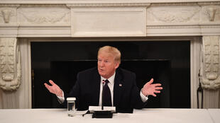 US President Donald Trump speaks during a meeting with restaurant executives at the White House May 18, 2020