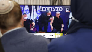 Israeli Prime Minister Benjamin Netanyahu (R) and Health Minister Yuli Edelstein (L) received the Pfizer-BioNTech vaccine live on TV at the Sheba Medical Center, the country's largest hospital, in Ramat Gan near the coastal city of Tel Aviv