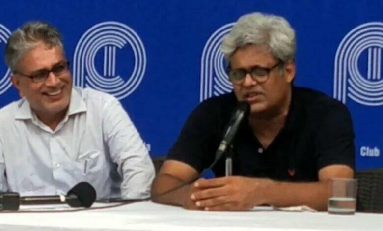 M K Venu of Wire addressing journalists at the Press Club of India.