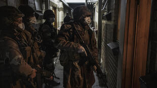 South African soldiers search an apartment block in Johannesburg on 2 April 2020.