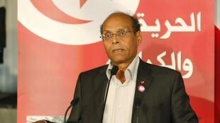 Marzouki speaks during celebrations marking the first year anniversary of the revolution in Tunis, 14 January