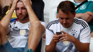 Les supporters allemands sont déçus après l'élimination de leur équipe.