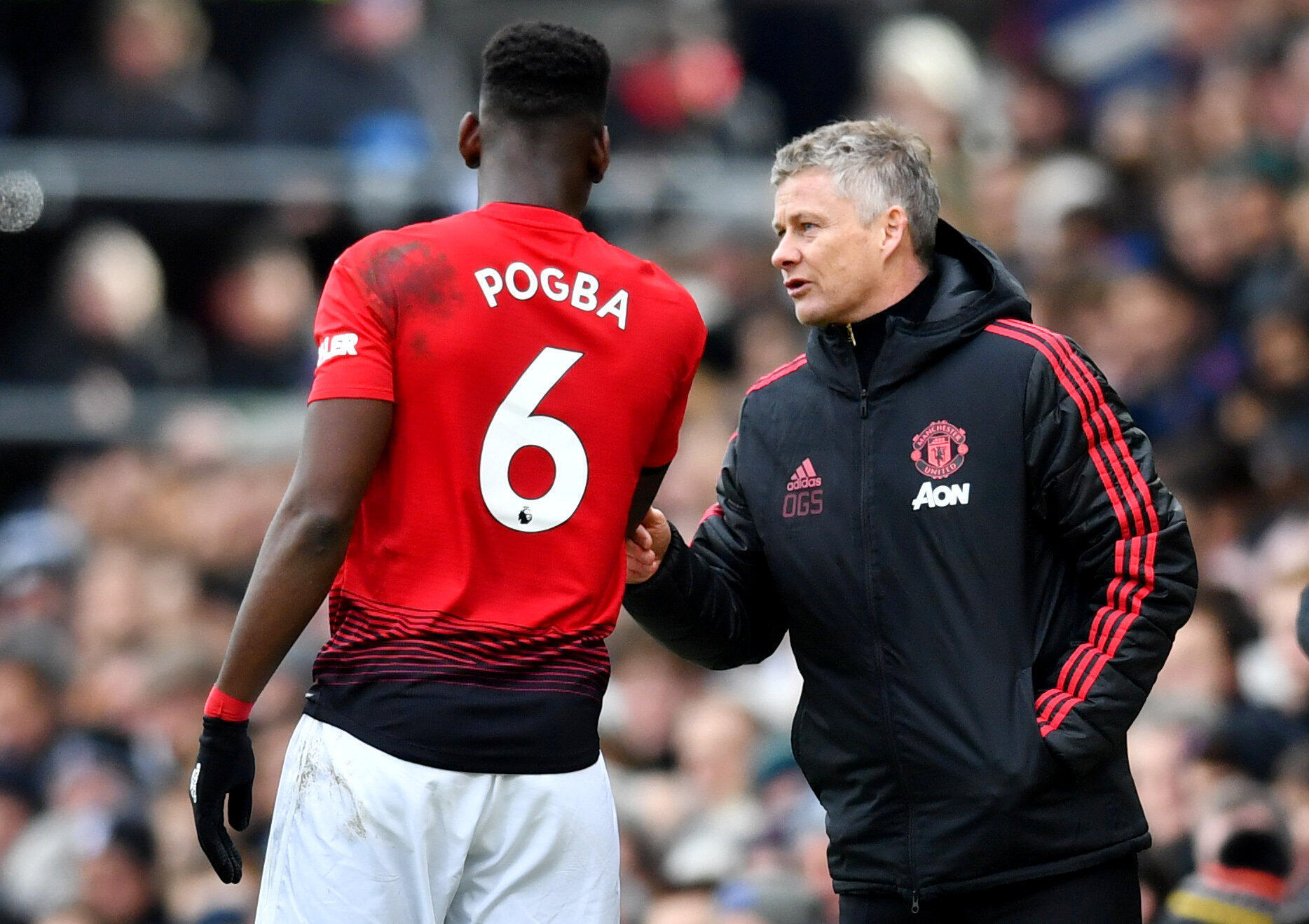 Dan wasan Manchester United Paul Pogba da mai horar da kungiyar Ole Gunnar Solskjaer.