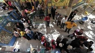 Egyptians waiting to vote in the constitutional referendum, Cairo 19 March 2011