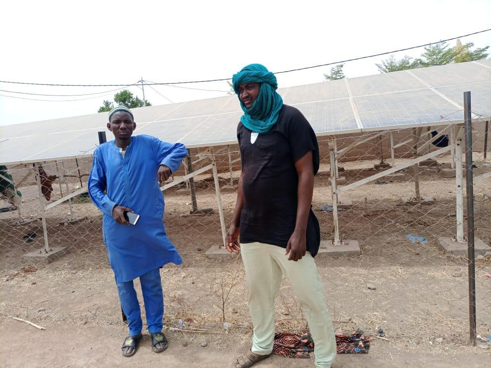 Baba Gambi (l), the controller of the solar panel plant in Séminbougou, Mali, and his nephew Cheick Tidiane Bah