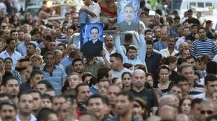 Residents take part in a funeral for victims of an attack on the Our Lady of Salvation church in Baghdad