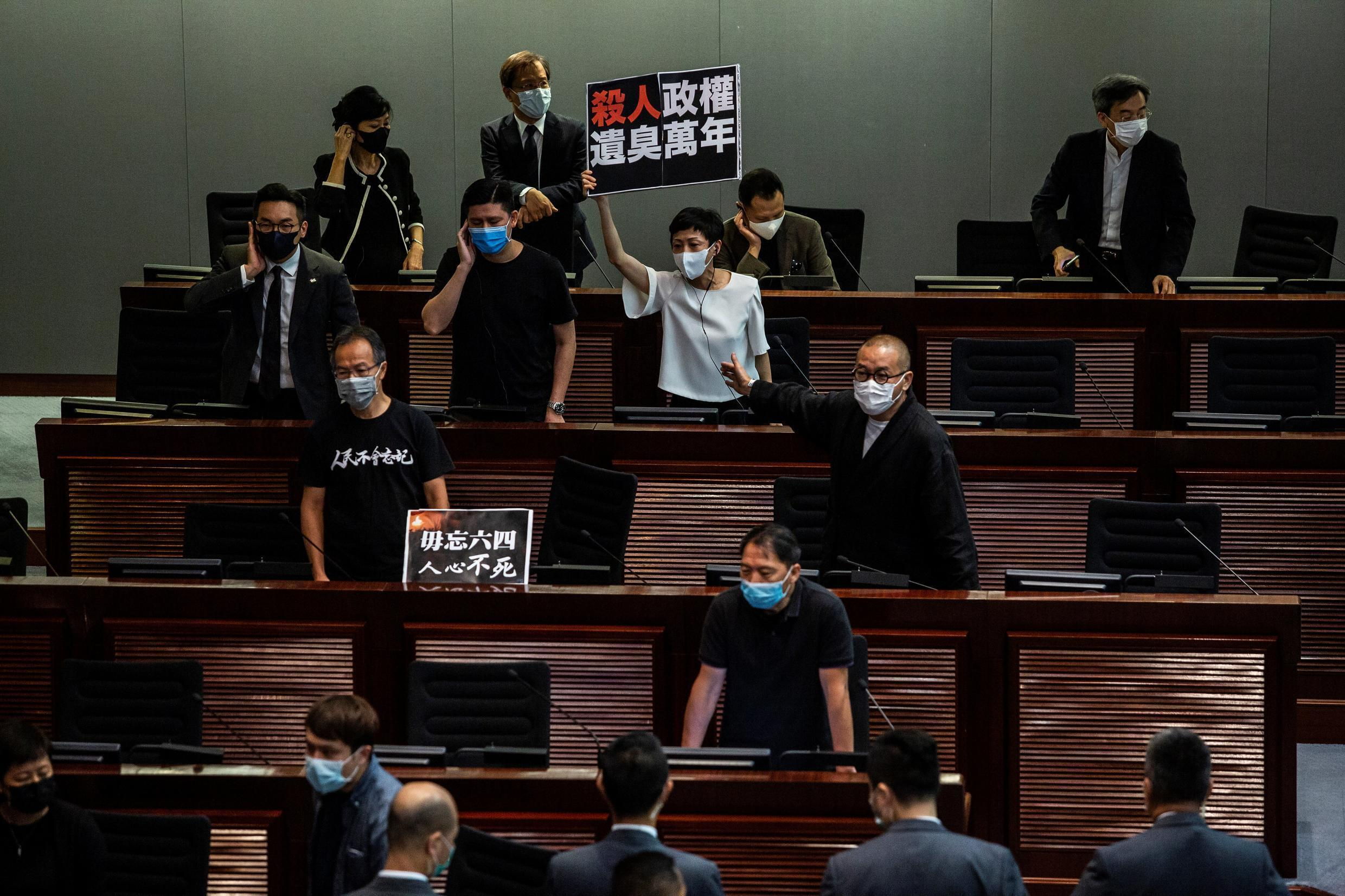 Pro-democracy MPs protest during the debate on the law prohibiting insults to the Chinese national anthem on June 4, 2020 at the Hong Kong Legislative Council