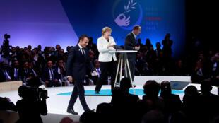 Tổng thống Pháp Emmanuel Macron và thủ tướng Đức Angela Merkel tại Diễn Đàn Hòa Bình Paris, tổ chức nhân kỷ niệm 100 năm ngày Đình Chiến 1918. Ảnh chụp tại Paris ngày 11/11/2018.