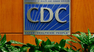 A podium with the logo for the Centers for Disease Control and Prevention in Atlanta, Georgia