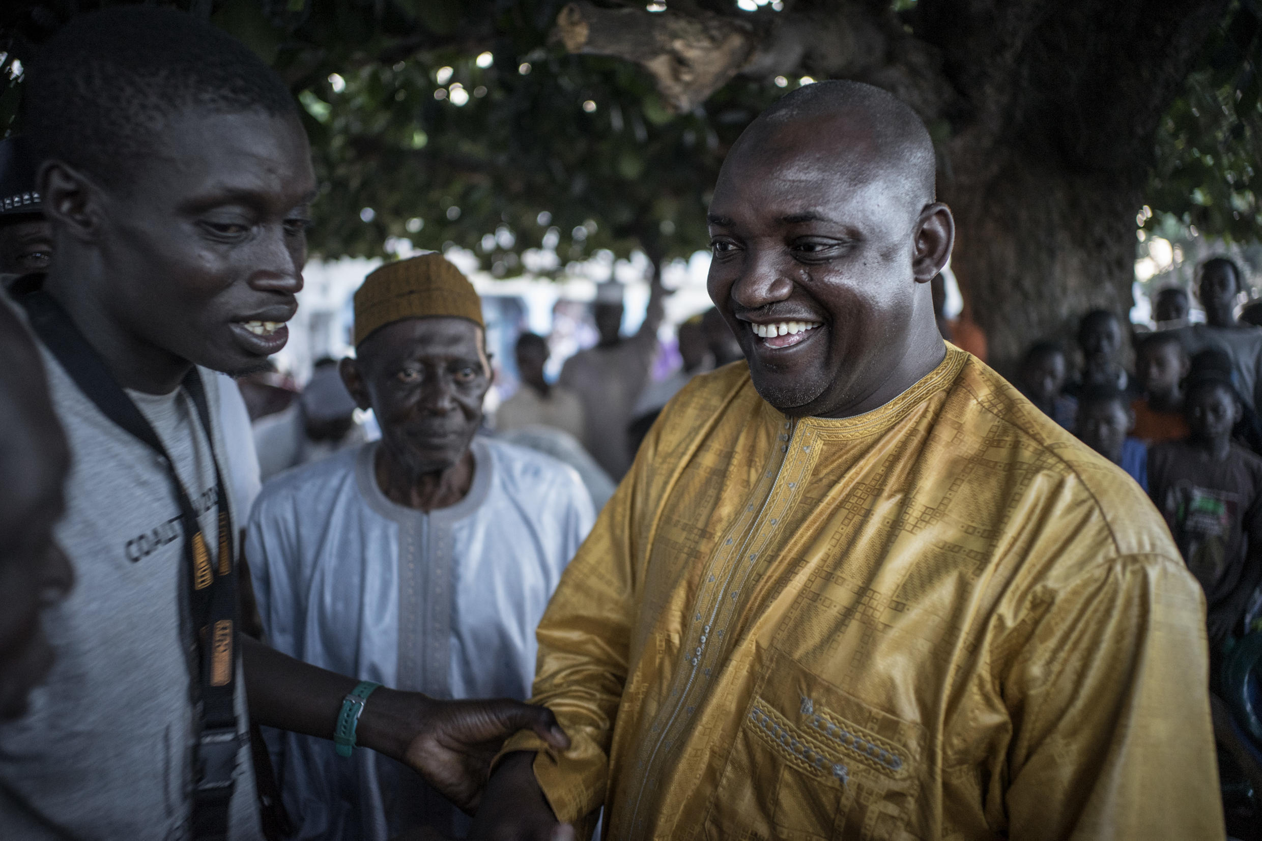 Adama Barrow greets supporters at a campaign rally in Jambur on 26 November 2016.