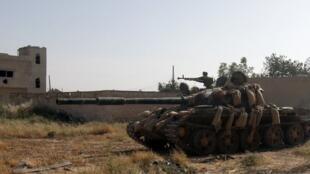 Un tank du régime syrien à Qousseir, le 25 mai 2013.