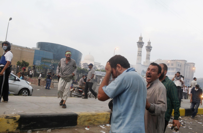 Un partisan de Mohamed Morsi, président déchu d'Egypte, blessé lors des heurts avec l'armée égyptienne pendant la manifestation de ce 27 juillet au Caire.
