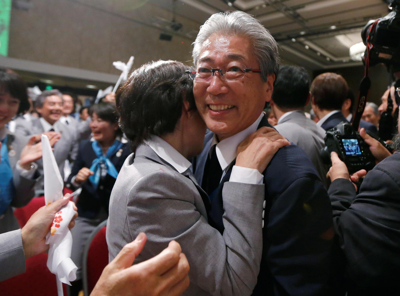 Глава Олимпийского комитета Японии Цунэкадзу Такэде празднует победу своей страны в конкурсе за проведение Олимпиады-2020, Буэнос-Айрес, сентябрь 2013.