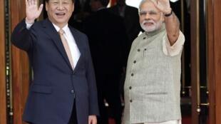 El presidente chino Xi Jinping y el premier indio Narendra Modi, este 17 de septiembre en Ahmedabad, India.