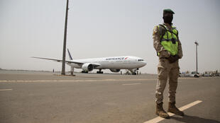 A Malian soldier guards the tarmac as doses of the AstraZeneca Covid-19 vaccine arrive as part of the Covax programme at the airport in Bamako, Mali, 5 March 2021.