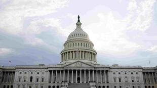 Fitch says it will rate again when congress reveals its deficit reduction plans