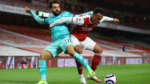 Liverpool forward Mohamed Salah (L) tussles with Arsenal defender Gabriel at the Emirates.