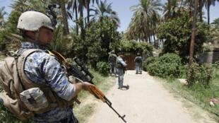 Patrouille des forces spéciales de la police irakienne au nord de Bagdad, le 30 juin 2014.