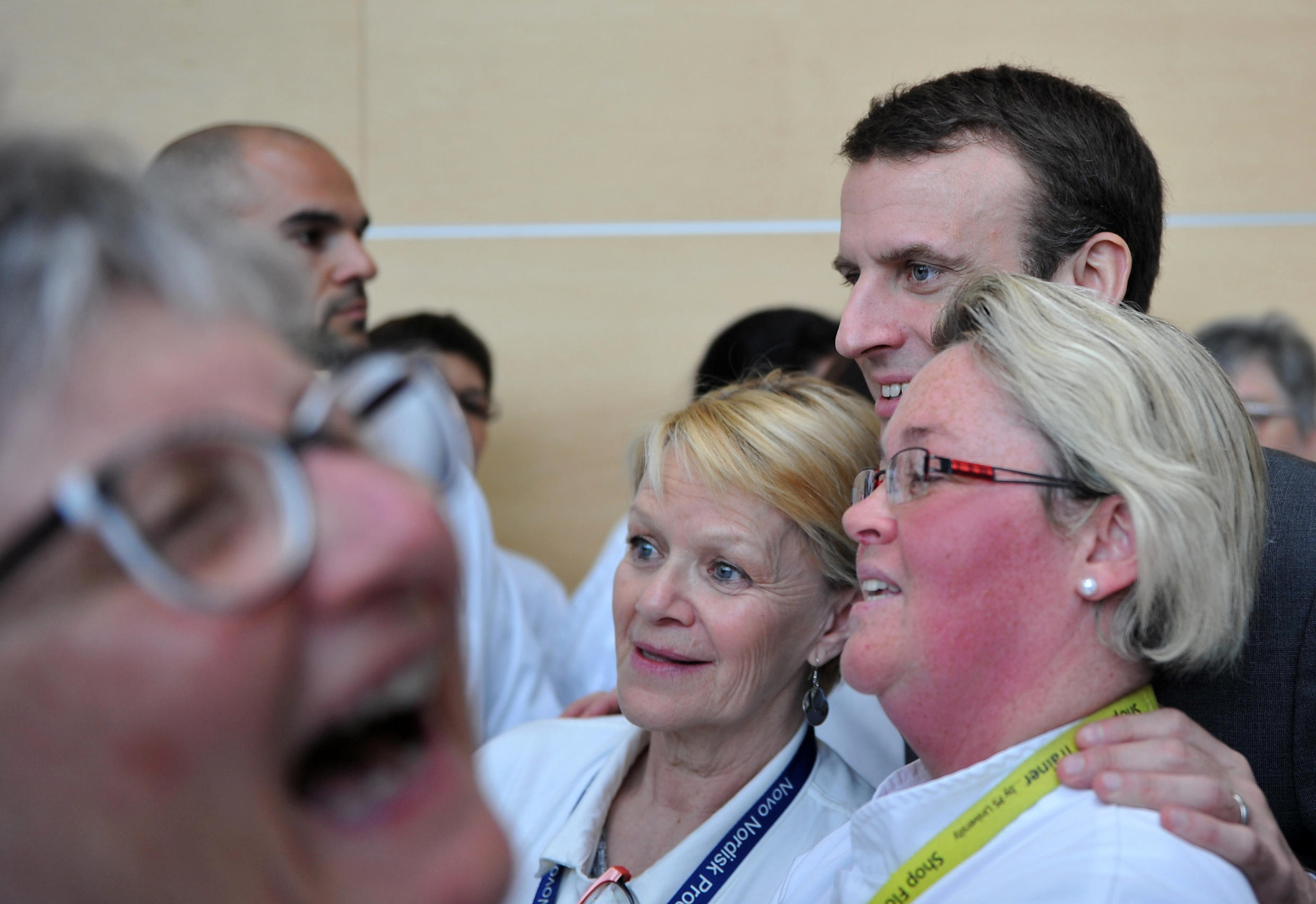 French Economy Minister Emmanuel Macron with women workers at a Novo Nordisk plant in Chartres