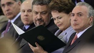 Brazilian President  Dima Rousseff (C) with Finance Minister Guido Mantega (2nd L), Chief of Staff Antonio Palocci, and Vice Pre